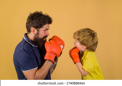 Box. Boxer. Ready for sparring. Little kid boxing with coach. Sport lifestyle. Training together. Family workout.