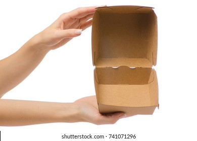 Box for a burger in a female hand on a white background isolation