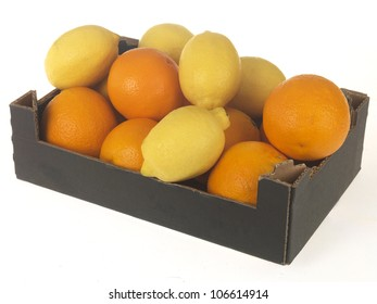 Box Or Carton of Fresh Ripe Whole Oranges and Lemons Isolated On White With No Clipping Path