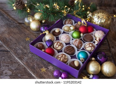 Box of chocolates with colorful baubles for a Merry Christmas