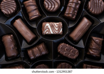 box of chocolates on table, view from above.