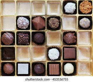 A box of chocolates partially empty viewed from above
