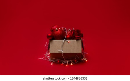 Box with christmas balls and decorations.  Top horizontal view copyspace.