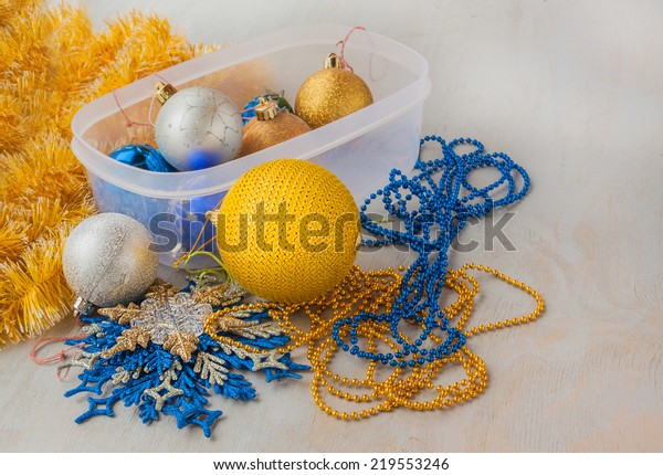 Box with Christmas decorations before starting holidays
