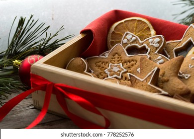 box with Christmas ginger cookies by the window