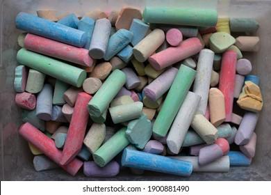 Box of colorful sidewalk chalk pieces