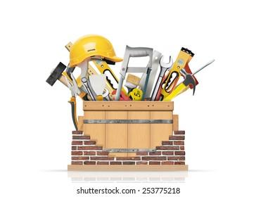 Box with construction tools and brick wall