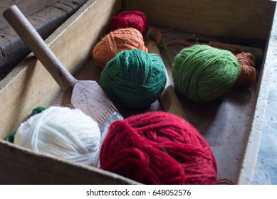 Box containing colored yarn balls for carpet weaving
