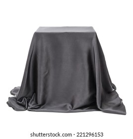 Box covered with black cloth.