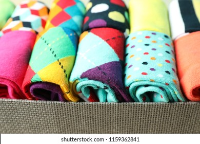 Box with different colorful socks, closeup
