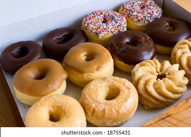 box of donuts - chocolate glazed, maple, sprinkles, honey cruller, traditional