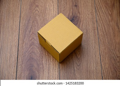 box empty open cardboard box on wooden surface with empty space top Flat lay