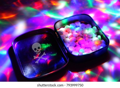 A box filled with ecstasy under disco lights./The dealer sells drugs to discos.