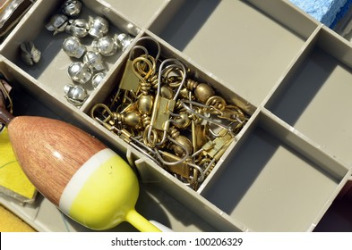 Box filled with small fishing necessities