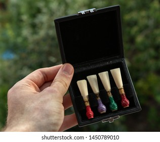 a box with four bassoon pipes