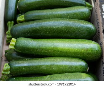 box of frech zucchini at a vegetable market