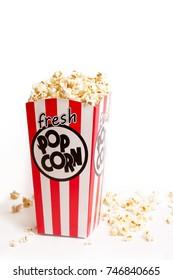 Box of fresh popcorn on white background