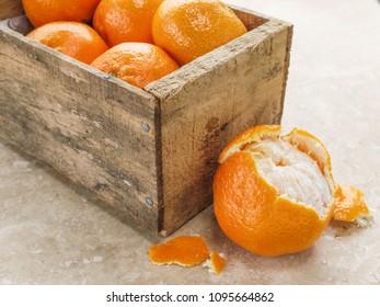 A box of fresh ripe juicy oranges.