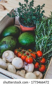 The box of fresh vegetables and herbs