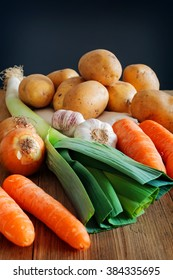 Box of fresh vegetables on a rustic wooden table