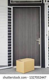 Box in front of door as delivery to doorstep concept