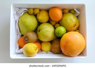 a box of fruits top view on a table