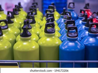 Box full of aluminum metallic water bottles at market ready to sell