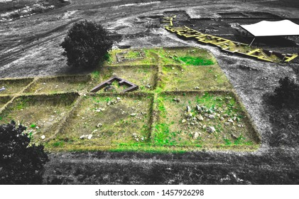 Box grid excavation of archaeological site.