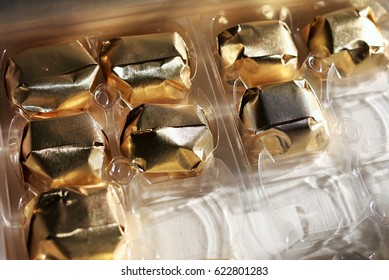 Box of Marrons glaces with golden wrap paper