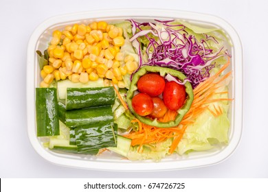 A box of mixed fresh vegetables salad, diet and healthy food concept.