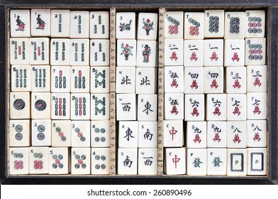 Box of old Mahjong tiles