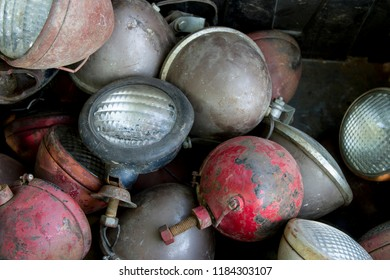 Box of old tractor headlights and lamps at a swap meet