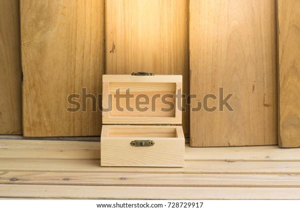 Box On Wood Board Backgroundusing Wallpaper Stock Photo