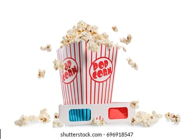 Box overflowing with popcorn and a pair of 3D glasses isolated on white background