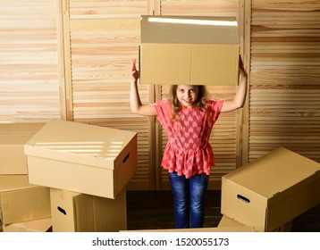 Box package and storage. Small child prepare for relocation. Relocating family can be exciting, but also stressful for kids. Kid girl relocating boxes background. Relocating concept. Delivery service.