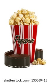 Box of popcorn and film isolated on white background. Clipping path included. Concept of Movie time or entertainment.