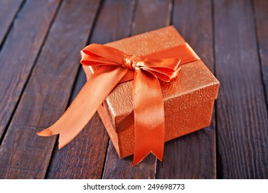 box for present on the wooden table