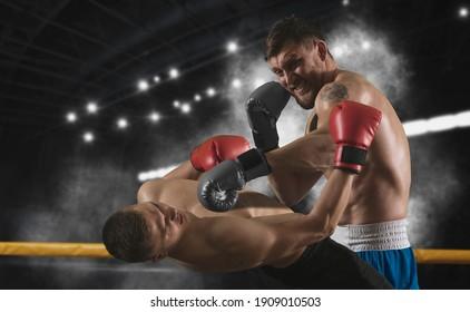 Box professional match on dark smoke background. Mixed media