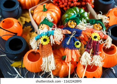 box  with pumpkins, scarecrows, lanterns on the dark background. Halloween decoration, concept