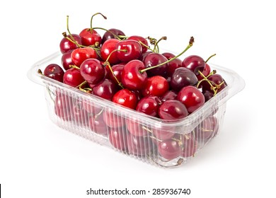 Box or punnet of fresh ripe organic cherries isolated on white background