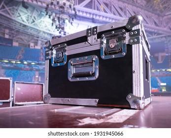 Box rack for transportation of concert equipment. Wardrobe trunk on background of concert venue. Rack wardrobe trunk on stage. Concept - sale of rack cases for concert equipment. Musical equipment