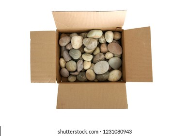 Box of rocks. Round River Rocks in a cardboard box. Isolated on white. Room for text. Dumber than a Box of Rocks.