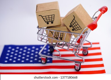 Box with shopping cart logo and America USA flag : Import Export Shopping online or eCommerce delivery service store product shipping, trade, supplier concept.