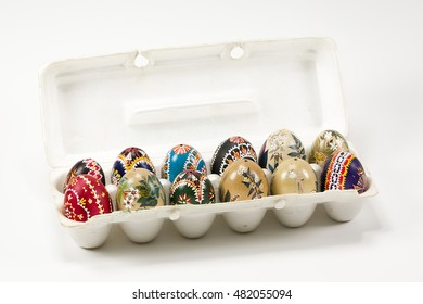 box of Sorbian painted easter egg on white background