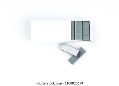 Box stack of metal staples on white background