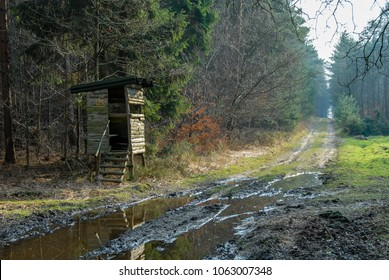 Box stand at a muddy forest path in Linsburg in winter