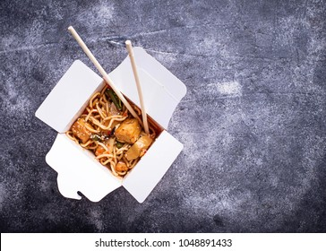 Box with Thai food. Noodles with chicken, tofu and vegetable