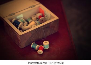 A box with threads. Image with selective focus and toning.