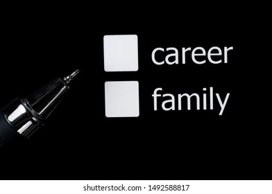 A box to tick off your choice between career and family. Squares on a black background.