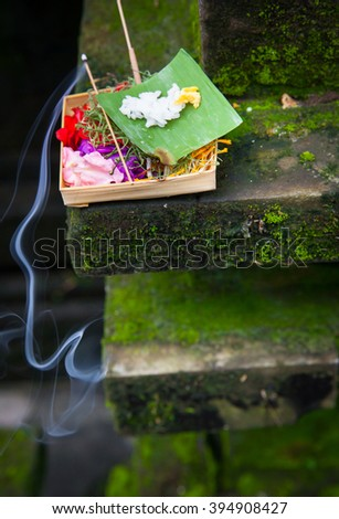 Box with traditional balinese morning offerings or Canang sari, Ubud, Bali, Indonesia